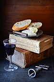 An arrangement of cheese, bread and red wine