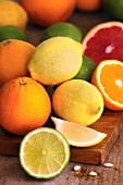 A selection of citrus fruits, whole and sliced
