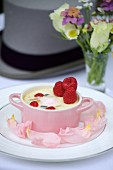 Creamy dessert with raspberry purée and fresh raspberries