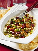 Mashed chickpeas with a dried fruit relish