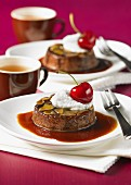 Chocolate and caramel flans with almonds and cherries