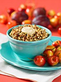 Plum and cherry muesli with chopped nuts and date purée
