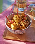 Crab balls with cocktail sticks in a bowl