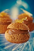 Profiteroles filled with chocolate cream topped with caramel threads