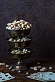 Pistachios on a stand with playing cards