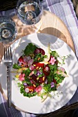 Beetroot and green kale salad with radishes, pears and flowers