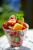 A fruit salad with quinoa and mint