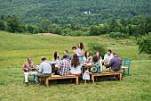 Family eating meal together outdoors