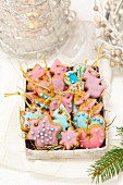 Gingerbread biscuits decorated with pastel coloured icing