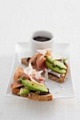 Wholemeal bread with tapenade, avocado, Parma ham and Parmesan cheese