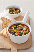 Provençal chicken soup with courgettes, tomatoes and peppers