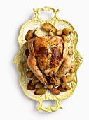A stuffed turkey on a old-fashioned serving platter