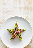 A star-shaped salad with bean sprouts and edible flowers