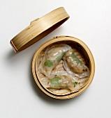 Dim sum dumplings in a bamboo steamer (Asia)