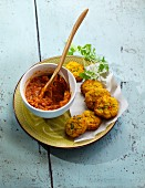 Sweetcorn balls with a red lentil sauce