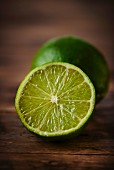 A lime on a wooden surface