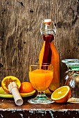 Orange juice in a glass and in a bottle