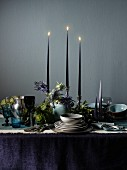 A festive table decorated in dark blue tones