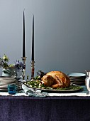 Roast turkey on a festive table