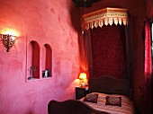 An oriental bedroom decorated in red tone, Larache, Morocco