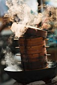 Steaming baskets in a wok, Leshan, Sichuan, China, Asia