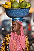 A woman selling fruit at the market in Ouagadougou, Burkina Faso, West Africa