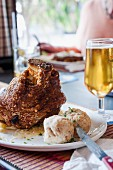Pork knuckle with dumplings and beer - Bavarian atmosphere in the 'Brauhaus' in Swakopmund, Namibia, Africa