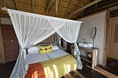 A cosy bedroom in a lodge in the Dolomite Camp in the Etosha National Park, Namibia