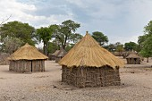 Traditionally built straw huts and farmsteads in the village of Morero near the Kwando River