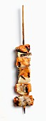 A grilled wild salmon skewer with onions