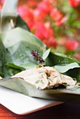 Steamed fish cakes in a banana leaf (Thailand)