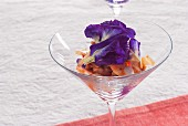 Shrimp cocktail with butterfly pea flowers (Thailand)