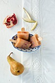 Pear ice lollies with pomegranate seeds