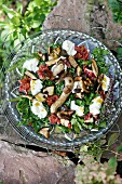An autumnal salad with rocket, fresh figs, fried porcini mushrooms and buffalo mozzarella
