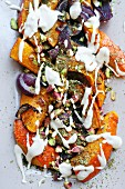Oven-roasted pumpkin with pistachio nuts, onions and yoghurt sauce