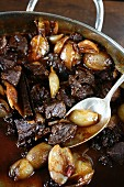 Stifado (Greek beef stew with onions and spices)