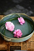 Roses and peonies in dish of water