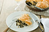 Vegetarian pie with wild rice, spinach, pine nuts and raisins