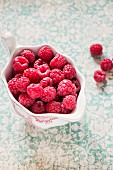 Raspberries in a porcelain bowl
