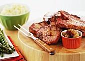 Pork chops on a chopping board
