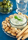 A basil and Pecorino dip served with savoury snacks