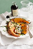 Oven-roasted pumpkin with cheese, hazelnuts and balsamic vinegar