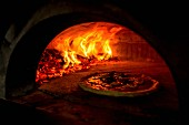 A Pizza Margerita in a wood-fired oven