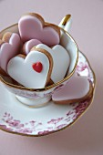 Heart-shaped biscuits in a teacup for Valentine's Day