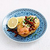 Baked potato with smoked salmon, lemon and sour cream