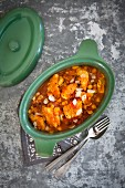 Fish stew with tomatoes and flaked almonds