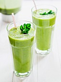 Green smoothies garnished with parsley