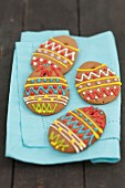 Decorated gingerbread eggs on a fabric napkin
