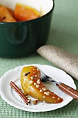Pumpkin in honey sauce with cinnamon and nuts