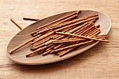 Pretzel sticks in a wooden dish